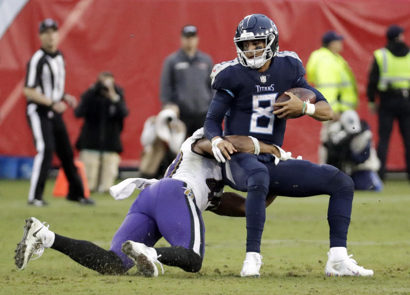 Tennessee Titans quarterback Marcus Mariota (8) is sacked for a 3-yard loss by Baltimore Ravens linebacker Kenny Young (40) in the second half of an NFL football game Sunday, Oct. 14, 2018, in Nashville, Tenn. (AP Photo/James Kenney)