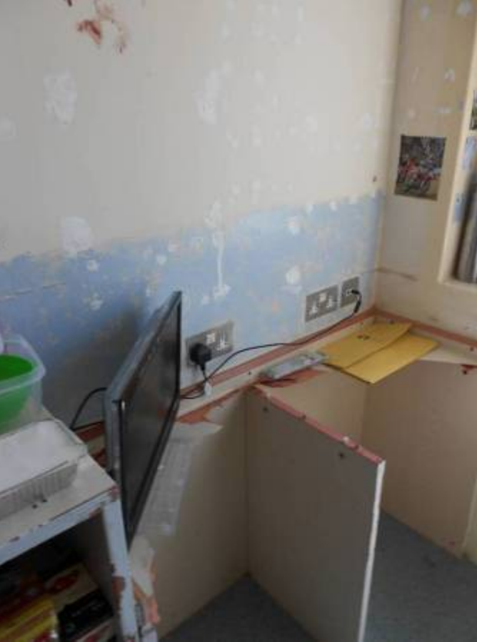 <p>One cell has broken furniture and a blood handprint on the wall. (Life in prison: Living conditions report) </p>