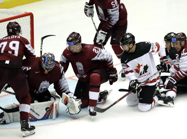 Ice Hockey - 2018 IIHF World Championships - Group B - Canada v Latvia - Jyske Bank Boxen - Herning, Denmark - May 14, 2018 -Goaltender Kristers Gudlevskis of Latvia tries to catch the puck. REUTERS/David W Cerny
