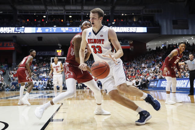 Belmont's Nick Muszynski (33) drives around Temple's Justyn Hamilton, center left, during the first half of a First Four game of the NCAA college basketball tournament, Tuesday, March 19, 2019, in Dayton, Ohio. (AP Photo/John Minchillo)