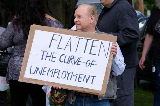 PHOTO: A man holds a placard during a demonstration in Milford, Pa. (Preston Ehrler/SOPA Images/LightRocket via Getty Images)