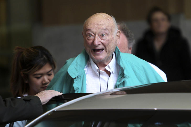 FILE - In this Dec. 10, 2012 file photo, former New York City Mayor Ed Koch says good-bye to reporters as he gets in his car after being released from the hospital in New York.  A spokesman says Koch now expects to get out of the hospital on Saturday, Jan. 26, 2013. Spokesman George Arzt said Friday that Koch originally expected to remain over the weekend at NewYork-Presbyterian/Columbia hospital. But doctors changed their minds and decided to let him out Saturday instead. He was admitted  last Saturday night with fluid in his lungs and swollen ankles. Doctors have told the 88-year-old ex-mayor to limit his salt intake. (AP Photo/Seth Wenig, file)