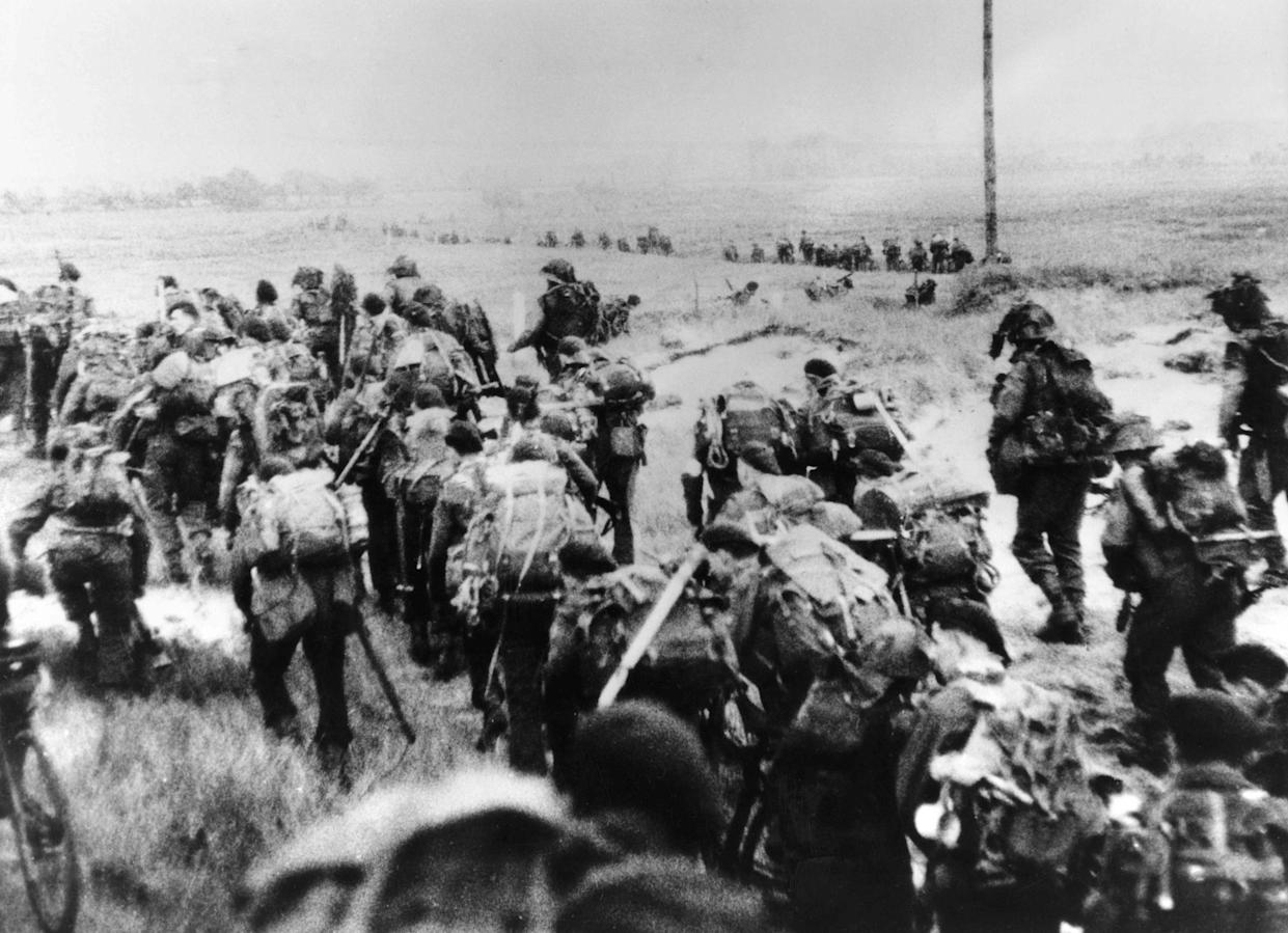 This file photo taken on June 6, 1944 shows the Allied forces soldiers landing in Normandy. - In what remains the biggest amphibious assault in history, some 156,000 Allied personnel landed in France on June 6, 1944. An estimated 10,000 Allied troops were left dead, wounded or missing, while Nazi Germany lost between 4,000 and 9,000 troops, and thousands of French civilians were killed. The 75th anniversary of the D-day landings will fall on June 6, 2019.