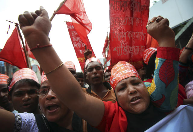 Protestors shout slogans during a May Day rally on Wednesday May 1, 2013 in Dhaka, Bangladesh. Thousands of workers paraded through central Dhaka on May Day to demand safer working conditions and the death penalty for the owner of a building housing garment factories that collapsed last week in the country's worst industrial disaster, killing at least 402 people and injuring 2,500. (AP Photo/Wong Maye-E)