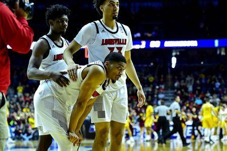 Mar 21, 2019; Des Moines, IA, United States; Louisville Cardinals guard Christen Cunningham (1) and Louisville Cardinals forward Jordan Nwora (33) react after the game in the first round of the 2019 NCAA Tournament at Wells Fargo Arena. Mandatory Credit: Jeffrey Becker-USA TODAY Sports