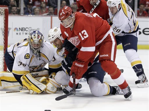 Nashville Predators goalie Pekka Rinne (35) of Switzerland, defenseman Shea Weber (6) and Detroit Red Wings center Pavel Datsyuk (13) of Russia look towards the puck during the first period of Game 4 of an NHL hockey Stanley Cup first-round playoff series in Detroit, Tuesday, April 17, 2012. (AP Photo/Carlos Osorio)