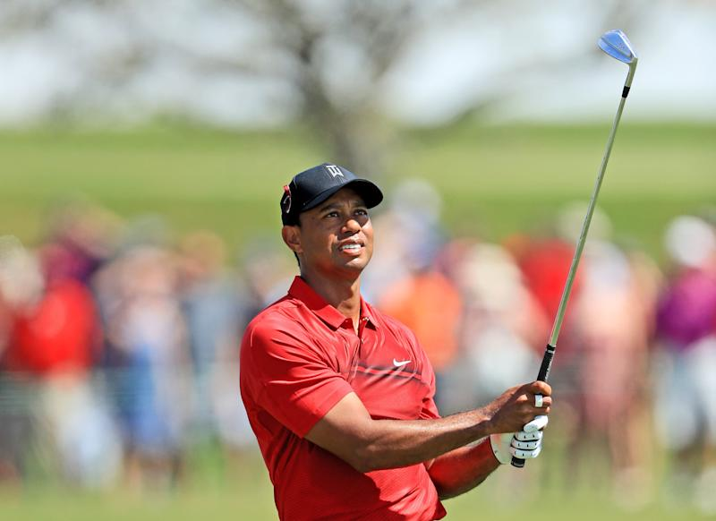 Woods takes share of Valspar clubhouse lead