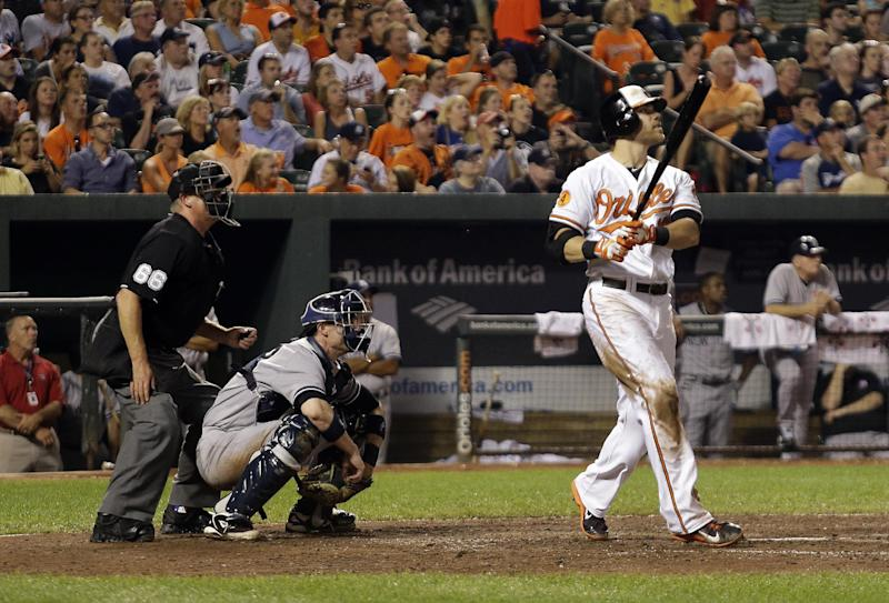 Baltimore Orioles' Chris Davis watches his two-run home run in the fifth inning of a baseball game against the New York Yankees, Tuesday, Sept. 10, 2013, in Baltimore. (AP Photo/Patrick Semansky)