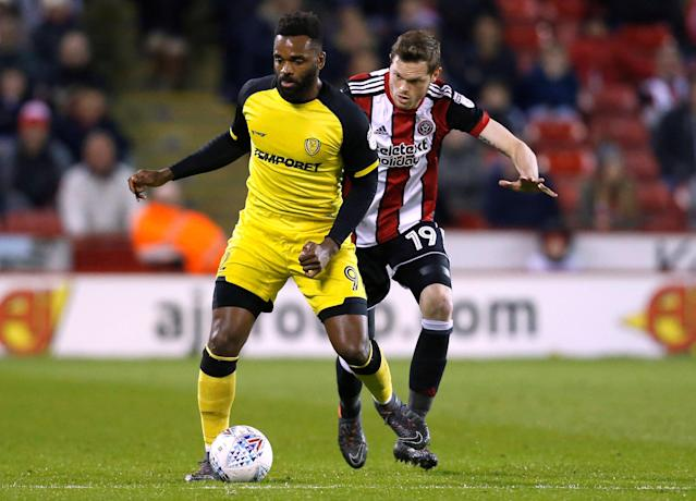 "Soccer Football - Championship - Sheffield United vs Burton Albion - Bramall Lane, Sheffield, Britain - March 13, 2018 Burton Albion's Darren Bent in action with Sheffield United's Richard Stearman Action Images/Ed Sykes EDITORIAL USE ONLY. No use with unauthorized audio, video, data, fixture lists, club/league logos or ""live"" services. Online in-match use limited to 75 images, no video emulation. No use in betting, games or single club/league/player publications. Please contact your account representative for further details."