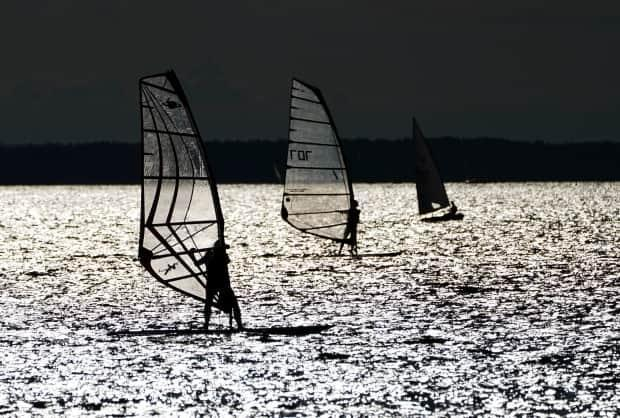 Sailors and windsurfers play in the winds on the Ottawa River in Ottawa in late July. (Sean Kilpatrick/Canadian Press - image credit)