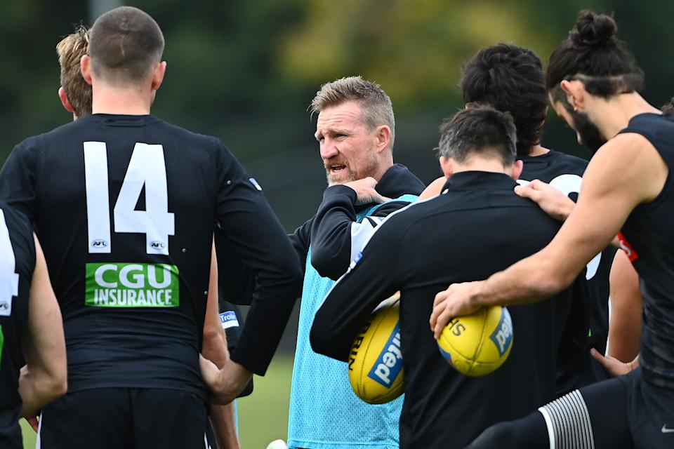 Magpies head coach Nathan Buckley talks to his players during a Collingwood Magpies AFL training session at The Holden Centre on May 04, 2021 in Melbourne, Australia.