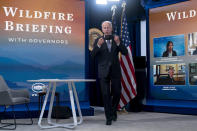 President Joe Biden arrives for a meeting with governors to discuss ongoing efforts to strengthen wildfire prevention, preparedness and response efforts, and hear firsthand about the ongoing impacts of the 2021 wildfire season in the South Court Auditorium in the Eisenhower Executive Office Building on the White House Campus in Washington, Friday, July 30, 2021. (AP Photo/Andrew Harnik)