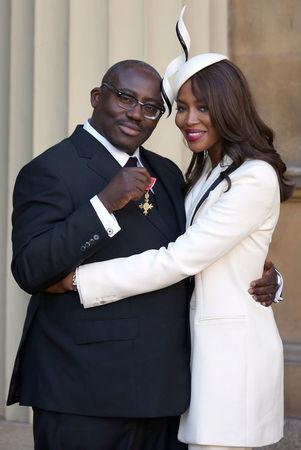FILE PHOTO: Model Naomi Campbell poses for a photograph with fashion stylist Edward Enninful, after Enninful received his Officer of the Order of the British Empire at Buckingham Palace, in London