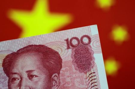 Yuan falls to fresh 11-year lows on trade war worries, despite state bank support