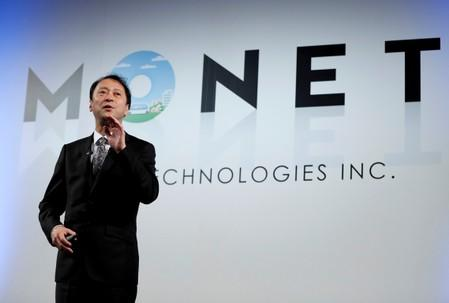 FILE PHOTO : Junichi Miyakawa, CEO of Monet Technologies Inc. speaks during a news conference in Tokyo