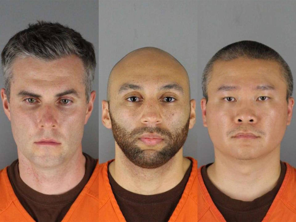 <p>Three former Minneapolis police officers, Thomas Lane (L), J Alexander Keung (C), and Tou Thao (R) will face August 2021 trial for their role in aiding and abetting Derek Chauvin in murder of George Floyd.</p> (Hennepin County Sheriff's Office via Getty Image)