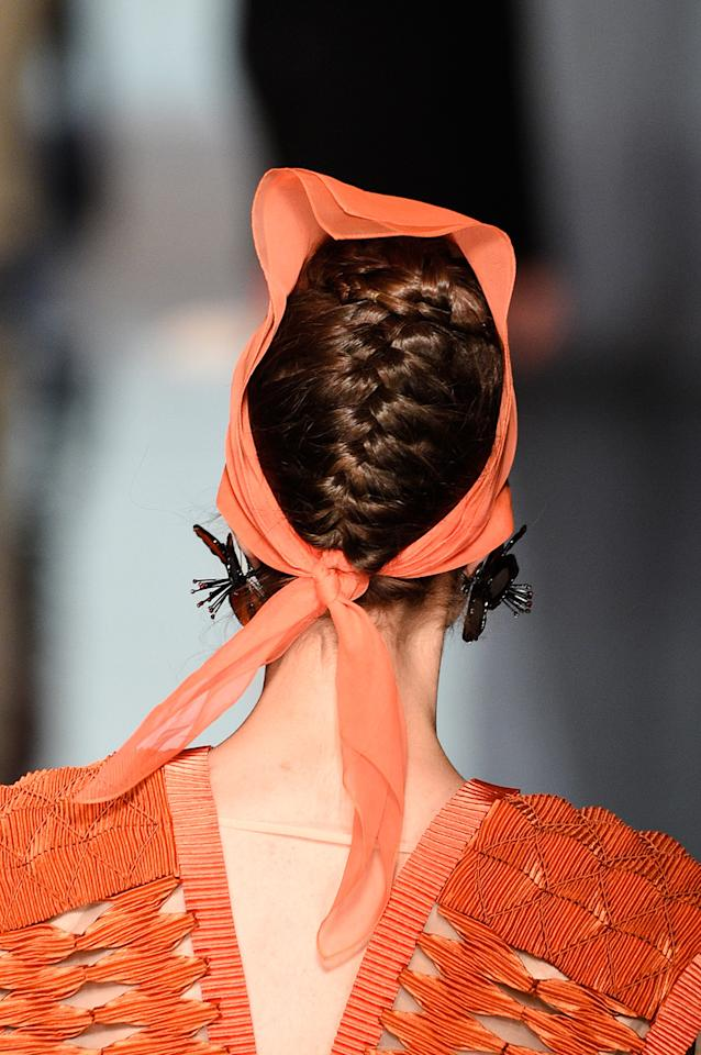 <p>A braided updo for work or play. (Photo: Getty Images) </p>