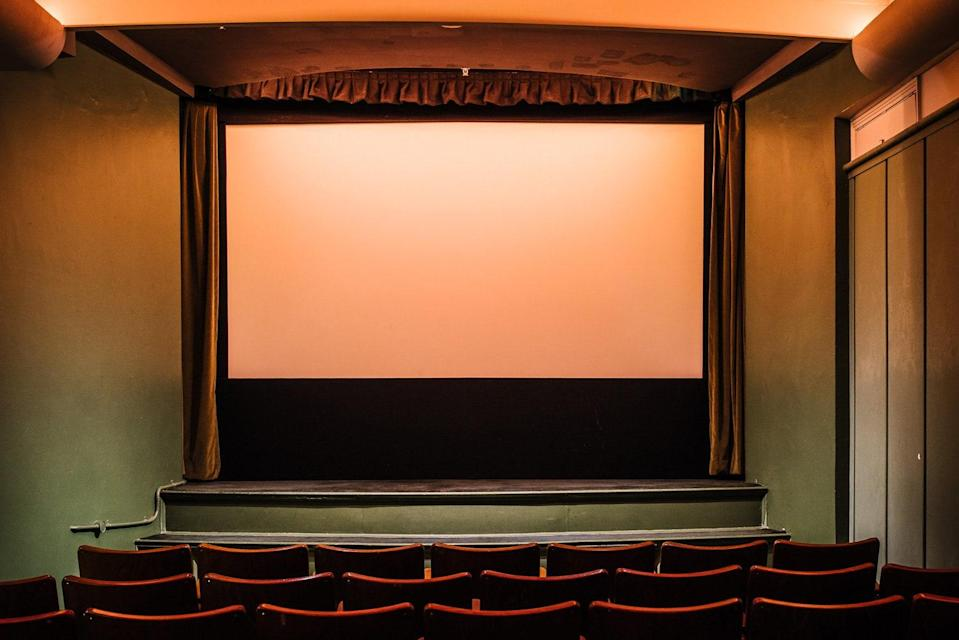 """<p><strong>Give us the big picture: What's the vibe of the place, what's it like?</strong><br> Travel back to a bygone era at the retro-chic Golden Age Cinema and Bar, a glamorous, intimate cinema with a handy watering hole attached. Set in the heritage-listed, Art Deco Paramount Pictures building in <a href=""""https://copilot.condenast.io/cnt/activities/607664021243ed65f16c0f48"""" rel=""""nofollow noopener"""" target=""""_blank"""" data-ylk=""""slk:Surry Hills"""" class=""""link rapid-noclick-resp"""">Surry Hills</a>, it was once the film company's screening room, but has been lovingly restored.</p> <p><strong>What kinds of events can we see here?</strong><br> Launched in 2013, Golden Age screens classic, cult, and contemporary new-release movies, with a penchant for Australian and independent films, creative feature pairings, and documentaries. The program also includes film trivia nights, DJ sessions, and music gigs by up-and-coming singer-songwriters and bands.</p> <p><strong>How are the seats?</strong><br> In keeping with the 1940-born building, the screening room is decked out in antique cinema chairs from Zürich hailing from the same era. The plush velvet-upholstered wooden seats are spacious and comfy, with plenty of legroom. Gorgeous mint-green walls and soft lighting add to the vintage mood, with all chairs offering a great view of the curtained mid-sized screen (seats are first-come, first-served, but there's not a bad one in the house). Some of the original projectors are still in play, but this is a state-of-the-art experience.</p> <p><strong>Good for kids?</strong><br> There's an adult vibe at the Golden Age, given it hosts a bar. Those under 18 must be accompanied by a guardian.</p> <p><strong>Anything in particular that makes this place special, from the programming to a unique feature it has?</strong><br> The alluring adjoining bar, inspired by director David Lynch and designed from scratch to match the cinema, is open for drinks before, during, or after the film. You can also"""