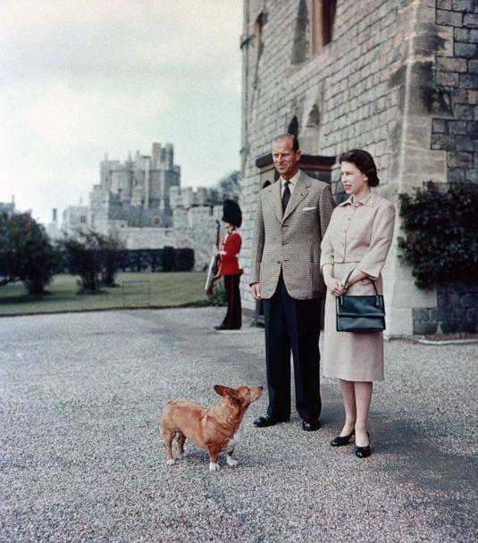 PHOTO: Queen Elizabeth II and Duke of Edinburgh at Windsor joined by Sugar, one of the Royal corgis, June 2, 1959. (PA Images via Getty Images, FILE)