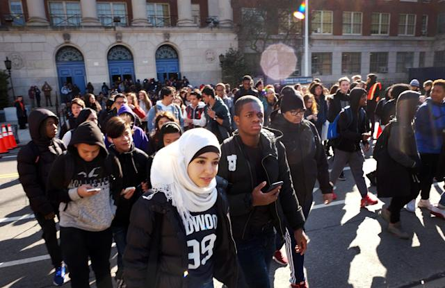 <p>Hundreds of students walk out of Midwood High School as part of a nationwide protest against gun violence, Wednesday, March 14, 2018 in the Brooklyn borough of New York. It is the nation's biggest demonstration yet of the student activism that has emerged in response to last month's massacre of 17 people at Florida's Marjory Stoneman Douglas High School. Midwood has a student population of almost 4,000. (Photo: Mark Lennihan/AP) </p>