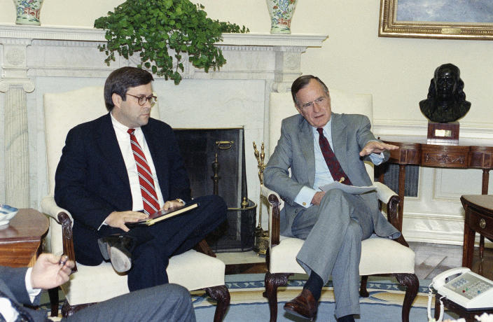 In 1992: President George H.W. Bush gestures while talking to Attorney General William Barr in the Oval Office. (Photo: Marcy Nighswander/AP)