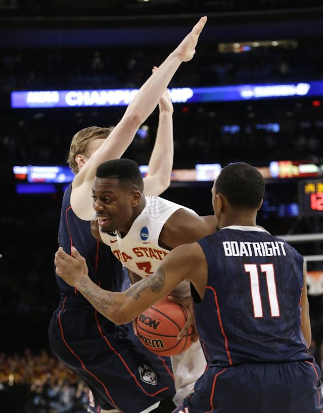 Iowa State's Melvin Ejim tries to move past Connecticut's Niels Giffey, left, and Ryan Boatright, right, during the first half in a regional semifinal of the NCAA men's college basketball tournament Friday, March 28, 2014, in New York. (AP Photo/Frank Franklin II)