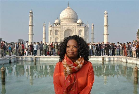 Oprah Winfrey, $165 million: Entertainment host Oprah Winfrey poses for pictures in front of the historic Taj Mahal during her visit to the northern Indian city of Agra January 19, 2012.