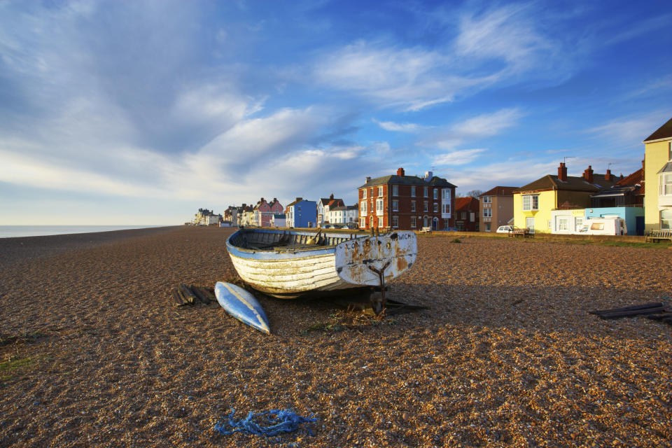 <p>Head to Suffolk to soak in the sun in this picturesque seaside town. Walk off a hangover (or your XL fish and chips portion) with a walk on the pebble beach. Visit in time for the yearly festival or to catch a concert at the nearby Snape Maltings. <em>[Photo: Getty]</em> </p>