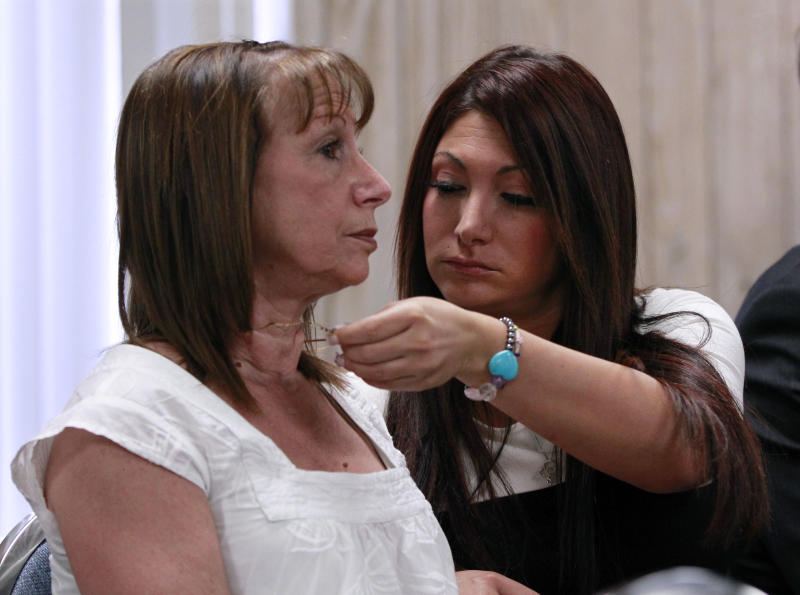 """""""Jersey Shore"""" cast member Deena Cortese, right, adjusts a necklace for her mother, Joann Cortese, as they wait in court Tuesday, July, 3, 2012, in Seaside Heights, N.J. Police arrested Cortese on June 10, saying she was dancing in a roadway and interfering with the flow of traffic. But municipal prosecutor Kim Pascarella said the prosecution did not have enough evidence to prove that charge, agreeing instead to allow her to plead guilty to the lesser offense of not using a sidewalk when one was provided. She pleaded guilty to failing to use the sidewalk and paid a $106 fine. (AP Photo/Mel Evans)"""