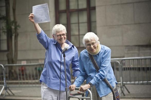 Phyllis Sifel (L) and Connie Kopelov celebrate after being married at the marriage bureau in lower Manhattan July 24, 2011.
