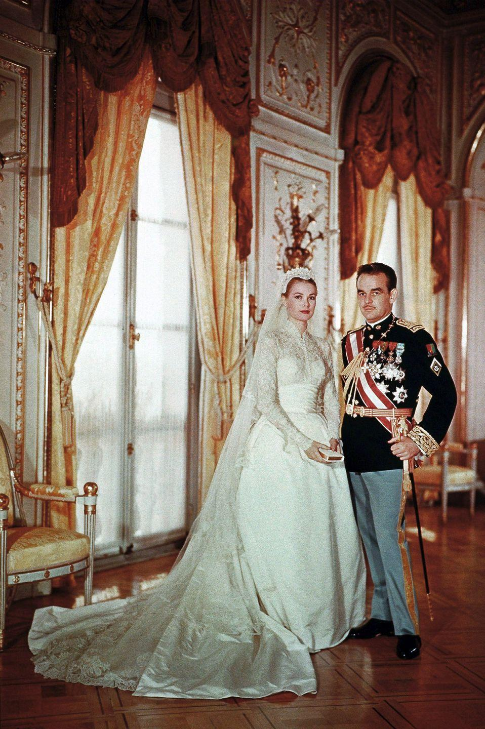"""<p>The actress-turned-royal chose a long-sleeve gown by costume designer <a href=""""https://www.goodhousekeeping.com/beauty/fashion/g4719/grace-kelly-wedding-gown/?slide=1"""" rel=""""nofollow noopener"""" target=""""_blank"""" data-ylk=""""slk:Helen Rose"""" class=""""link rapid-noclick-resp"""">Helen Rose</a>.</p>"""
