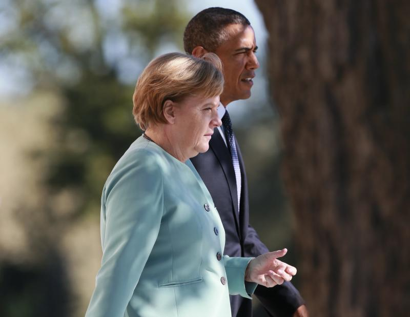 German Chancellor Merkel and U.S. President Obama walk together during the family picture event during the G20 summit in St.Petersburg