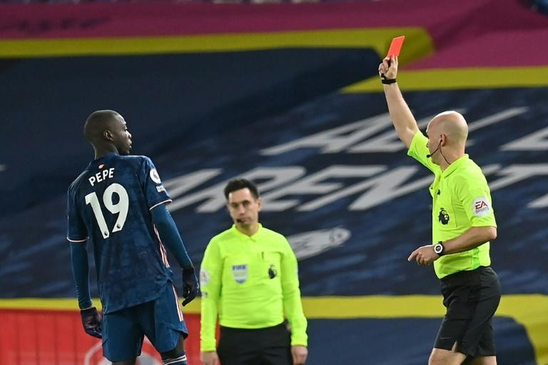 Arsenal held out for a 0-0 draw at Leeds despite Nicolas Pepe's (left) red card
