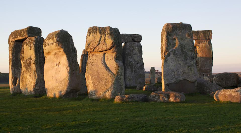 A picture shows the prehistoric monument of Stonehenge, a UNESCO World Heritage Site, on Salisbury Plain in Wiltshire, in central southern England, on July 12, 2012. The site of Stonehenge is situated on Salisbury plain in an area of dense prehistoric activity dating back as early as 8,000 BC. The large sarsen stones for which the site is famous were erected during the Bronze Age between 2600 and 2400 BC within and amid earlier earthworks, postholes and smaller stones. in 1986 the site was designated a UNESCO World Heritage Site and it remains the most wellknown prehistoric monument in Britain. AFP PHOTO / ANDREW COWIE        (Photo credit should read ANDREW COWIE/AFP via Getty Images)