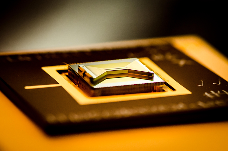 A chip containing an ion trap that researchers use to capture and control atomic ion qubits (quantum bits). (Kai Hudek/JQI)