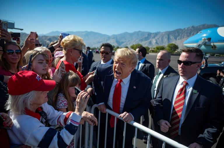 US President Donald Trump speaks with supporters as he arrives in Palm Springs, California, on February 19, 2020