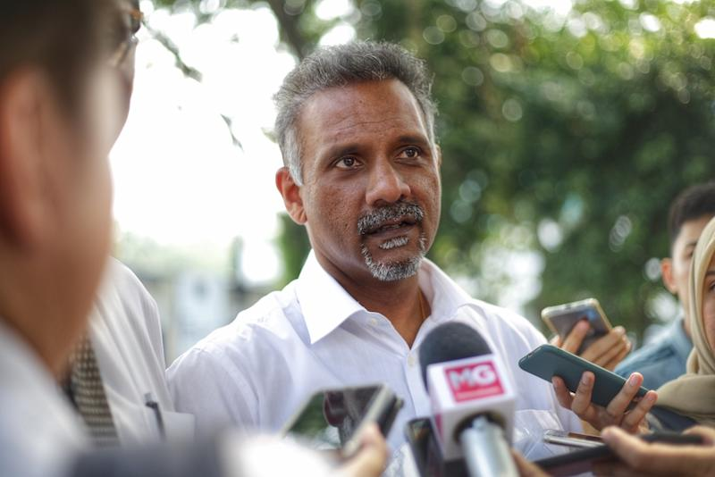 File photo of Ramkarpal Singh speaking to reporters outside Bukit Aman police headquarters in Kuala Lumpur October 14,2019. — Picture by Ahmad Zamzahuri