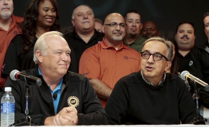 Fiat Chrysler Automobiles (FCA) CEO Sergio Marchionne (R) and United Auto Workers (UAW) union President Dennis Williams announce a tentative agreement during a news conference in Detroit, Michigan