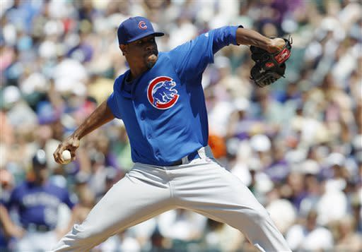 Chicago Cubs starting pitcher Edwin Jackson works against the Colorado Rockies in the first inning of a baseball game in Denver, Sunday, July 21, 2013. (AP Photo/David Zalubowski)