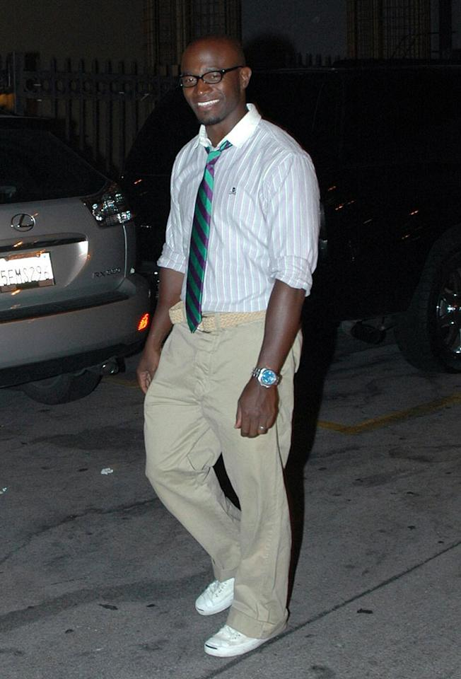 "Taye Diggs perfects his preppy look with a black plastic pair of glasses. G-Hollywood/<a href=""http://www.splashnewsonline.com"" target=""new"">Splash News</a> - July 21, 2007"