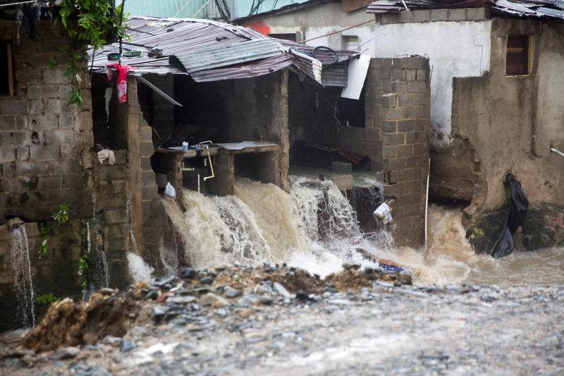 Water gushes from a destroyed house in Santo Domingo as it causes some to collapse on August 23, 2020 as Tropical Storm Laura batters the region. - Tropical Storm Laura hammered Hispaniola island with heavy rain killing at least three people in the Dominican Republic and five in Haiti, and was set to become a hurricane on Tuesday. (Photo by Erika SANTELICES / AFP) (Photo by ERIKA SANTELICES/afp/AFP via Getty Images)
