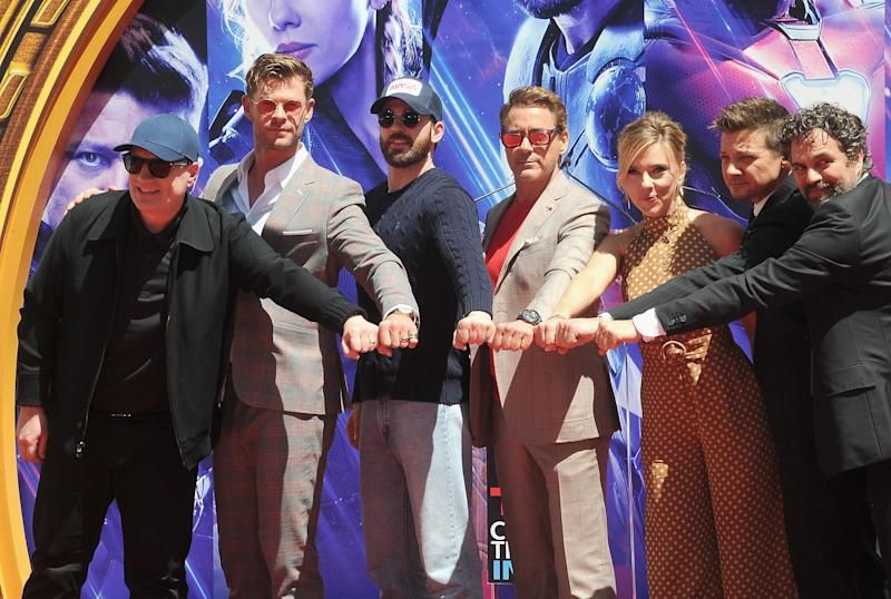 "HOLLYWOOD, CA - APRIL 23: Kevin Feige, Chris Hemsworth, Chris Evans, Scarlett Johansson, Mark Ruffalo and Jeremy Renner attend Marvel Studios' ""Avengers: Endgame"" Cast Place Their Hand Prints In Cement At TCL Chinese Theatre IMAX Forecourt held at TCL Chinese Theatre IMAX on April 23, 2019 in Hollywood, California. (Photo by Albert L. Ortega/Getty Images)"