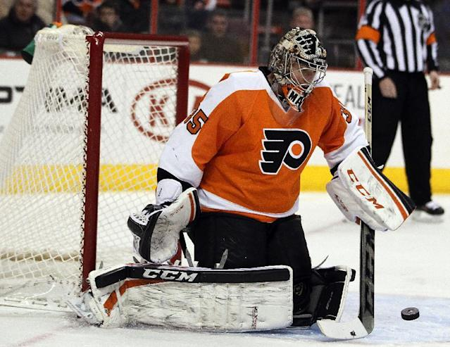 Philadelphia Flyers' Steve Mason deflects a shot on goal during the first period of an NHL hockey game against the Carolina Hurricanes, Wednesday, Jan. 22, 2014, in Philadelphia. (AP Photo/Tom Mihalek)