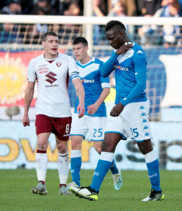 Brescia's Mario Balotelli, right, walks on the pitch during the Serie A soccer match between Brescia and Torino at the Mario Rigamonti Stadium in Brescia, Italy, Saturday, Nov. 9, 2019. (Filippo Venezia/ANSA via AP)