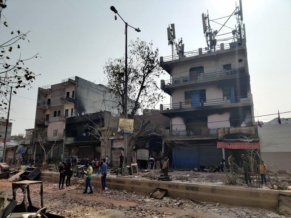 """<div class=""""paragraphs""""><p>This is Tahir Hussain's house buzzing with mediapersons and policemen on 27 February 2020.</p></div>"""