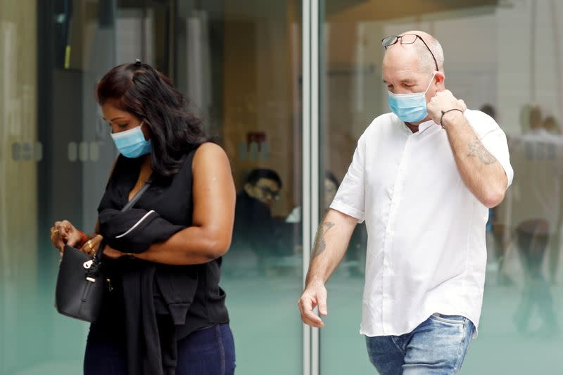 Briton Skea Nigel and partner Agatha Maghesh Eyamalai arrive at the State Courts in Singapore