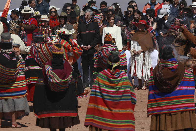 Amayran spiritual guides surround Bolivia's Vice President Alvaro Garcia Linera, center in black, and his bride Claudia Fernandez at the start of their wedding ceremony in Tiwanaku, Bolivia, Saturday, Sept. 8, 2012. The ceremony uniting the 49-year-old vice president with the 25-year-old journalist was held at a temple of stone walls, an ancestral site constructed by the ancient Aymara people some 3,000 years ago to observe the heavens. (AP Photo/Juan Karita)
