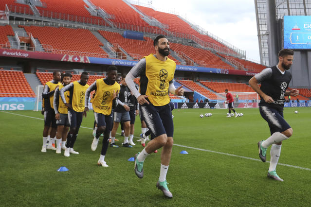 France's Adil Rami and Olivier Giroud warm up during France's official training at the eve of the group C match between France and Peru at the 2018 soccer World Cup in Yekaterinburg, Russia, Wednesday, June 20, 2018. (AP Photo/David Vincent)