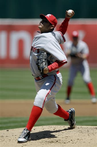 Seattle Mariners' Felix Hernandez works against the Oakland Athletics in the first inning of a baseball game, Sunday, July 8, 2012, in Oakland, Calif. (AP Photo/Ben Margot)