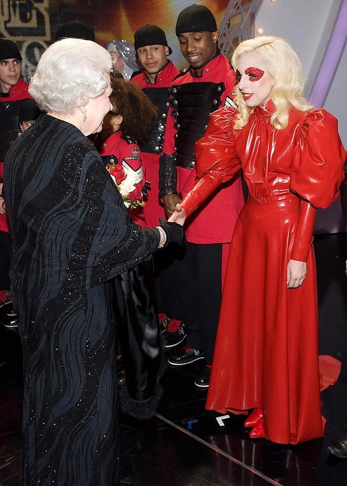 """Along with Miley, Lady Gaga was one of the many artists who sang for Queen Elizabeth II on Monday at the Royal Variety Performance in Blackpool, England. Gaga wore a gown made of PVC and played a 20-foot-tall piano. Leon Neal/ WPA Pool/<a href=""""http://www.gettyimages.com/"""" target=""""new"""">GettyImages.com</a> - December 7, 2009"""